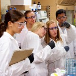 rsz_graduate-student-sarena-horava-helping-high-school-students-in-the-lab